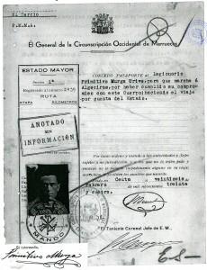 Documento en el que aparece una fotografía y la firma del legionario Primitivo Murga